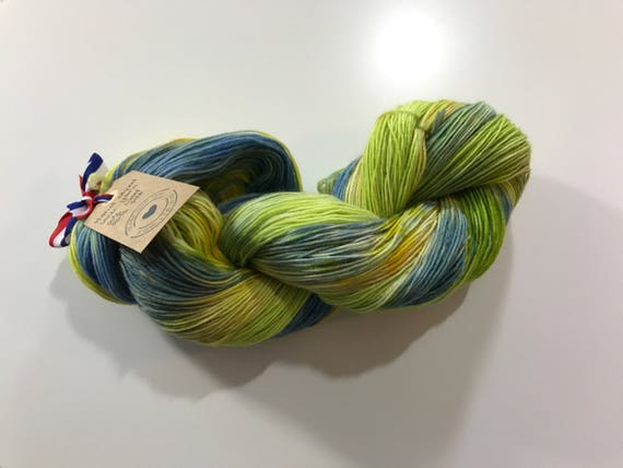 Hand dyed Merino and silk sock yarn in green, yellow and blue.