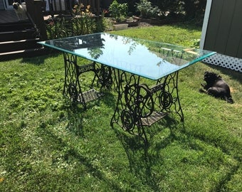 Double Singer treadle dining room table with beveled glass top