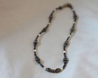 """16"""" Brown beaded necklace."""