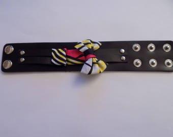 Cuff Bracelet black and subtle pink/yellow/white/black wax.