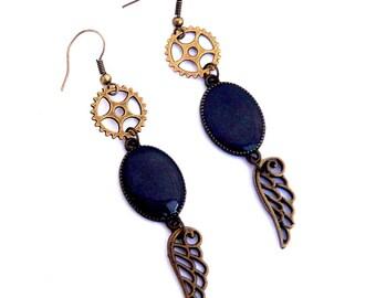 Steampunk gear and wing purple dangle earrings