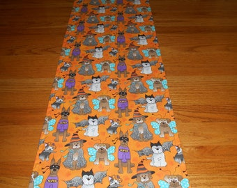"""TRH-12 52""""X13""""  Halloween runner with an assortment of adorable dogs in unique and colorful costumes."""