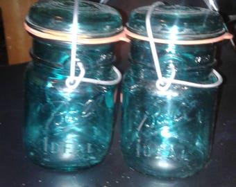 2 blue ideal Mason jars with lids