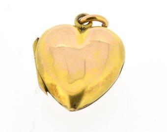 A vintage heart shaped 9ct gold locket.