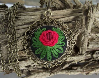 Hand embroidered pendant with rose