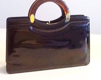 Vintage black patent structured handbag, lucite handle, navy leather sides, beige suede lined, elegant and chic, made in England by Widegate
