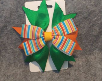 Colorful striped hair bow.