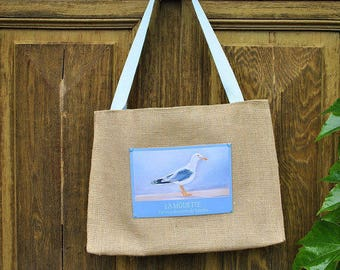 A burlap bag and its pretty Seagull