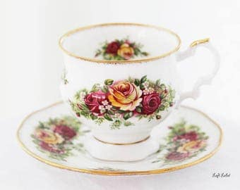 """Elizabethan Teacup, Red Roses, """"Elizabethan Garden"""", ft. colourful Red, Yellow Roses, pure white base, gold sprinkle trimming, England"""