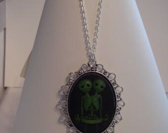 Gothic cameo pendant of two Siamese skeletons