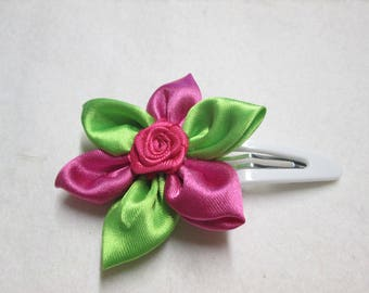 Adorned with a satin flower hair clip