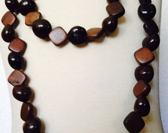 Long necklace with beads in Brown and Lumbang seed