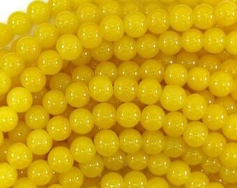 """8mm glass round beads 14"""" strand yellow 32506"""