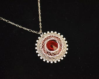 Necklace, sterling silver and ruby red swarovski necklace