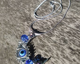 Evil eye moon pendant