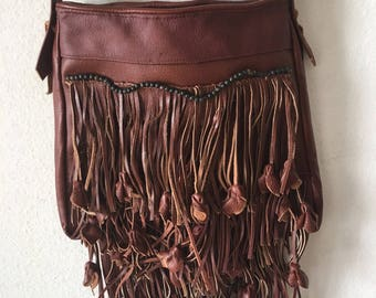 Real crossbody bag handmade bag from genuine leather with elements of fashionable leather fringe new women's brown color has size-medium.