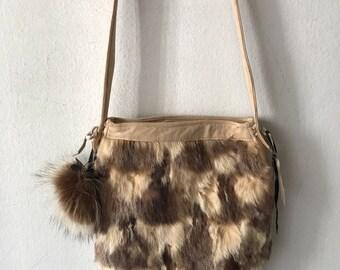 Rabbit fur hand made fur bag .