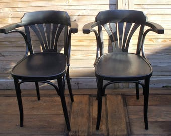 Two wooden Thonet style chairs.