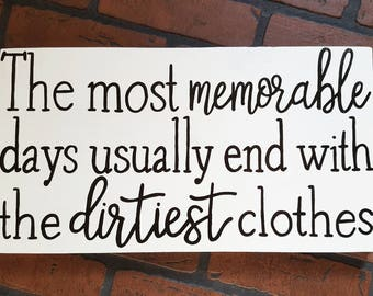The most memorable days usually end with the dirtiest clothes wood sign