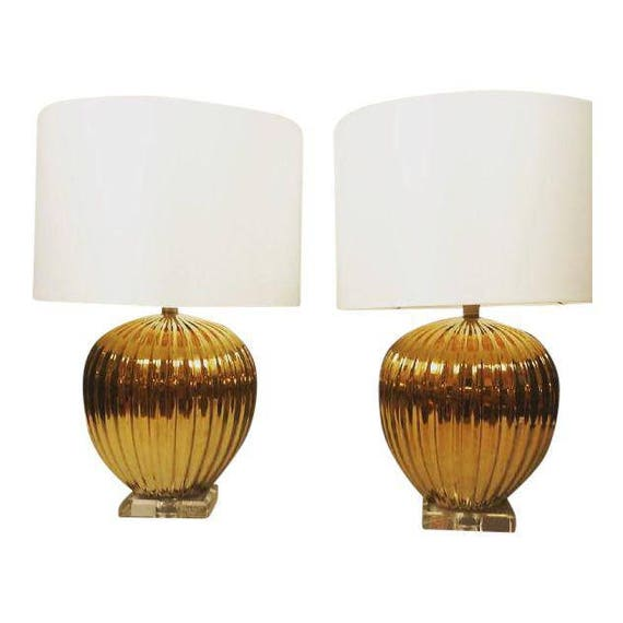 Hollywood Regency pair of Melon shape gold ceramic table lamps with lucite base