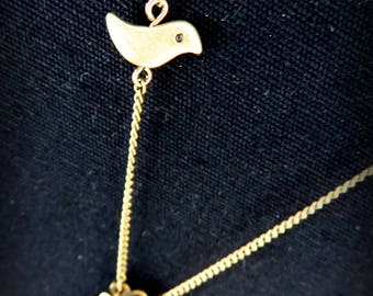 Necklace brass bird and green enamel leaves