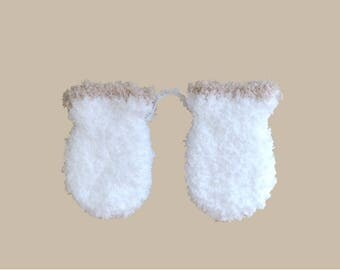 baby white fur mittens very soft and border beige