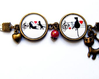 "Bracelet two medallions ""cat on a range of music"""