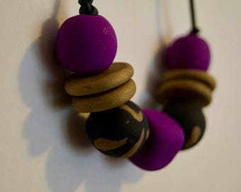 Polymer clay necklace, purple, gold, black, leather, bead necklace