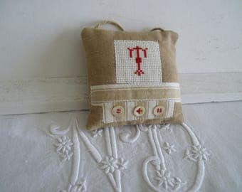Pillow of door initial embroidered T Monogram cross stitch