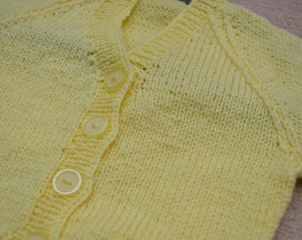 Pale yellow knit cardigan