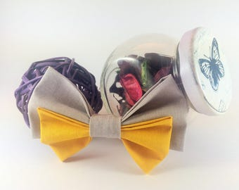 Bow tie brooch yellow and grey