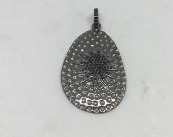 Pave black spinal charm