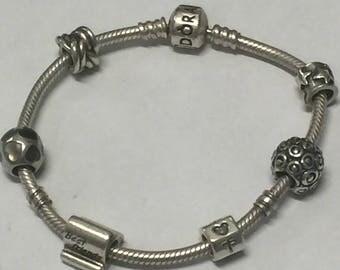 Authentic Pandora Bracelet w/ 6 authentic Pandora Charms 925
