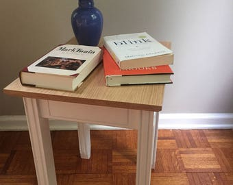 Small end table with fluted legs and decretive inlay