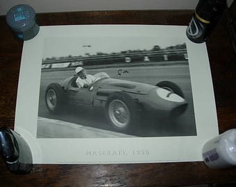 print of stirling moss in 1956 maserati , signed by him