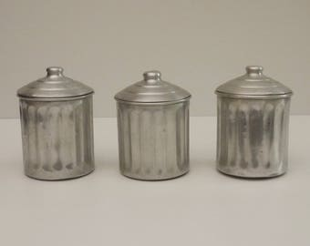 Antique french Hammered Metal Kitchen Canisters Set of 3, Cottage Chic. 1950's set of 3 jars with spices aluminum hammered with lids