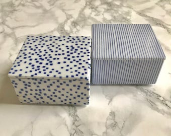 Nice set of two covered porcelain boxes decorated in blue and white