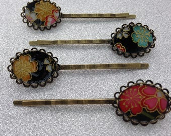 Hair clip, black paper garlands of multi-colored flowers.