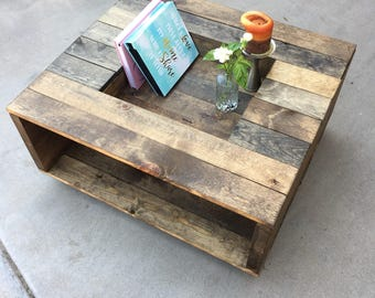Open  Sided Rustic Wood Coffee Table With Antique Wheels And Center Shelf Gallery