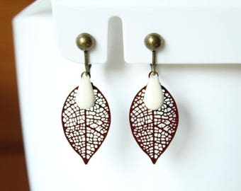 Featuring a Brown filigree leaf and creamy white enameled sequin drop clip earrings
