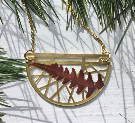 Brass half filigreed circle with tropical red fern necklace