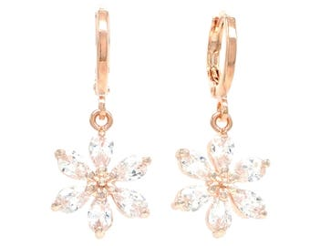 Authentic rose gold plated drop flower earrings with clear raindrop petal gemstones, clear white dazzling stones, black gift box purple bag