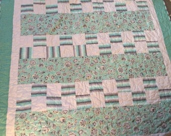 Gray and green quilt