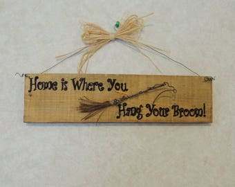 Home is where you hang your broom sign