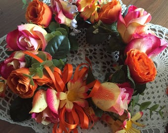 Center piece candle ring  9 inches across roses  dasies  237