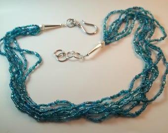 6 Strand Aqua Seed Bead Necklace