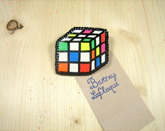 Pin the rubik's cube beads and leatherette