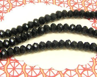 120 black donut DO39 opaque 4 * 3 mm faceted glass beads