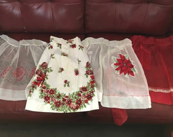 Four homemade Christmas aprons