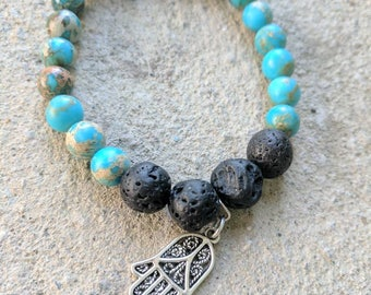 Turquoise and lava beaded charm bracelet